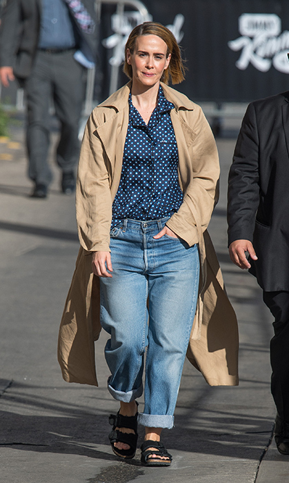Sarah Paulson looked comfy, cool and casual while arriving at <em>Jimmy Kimmel Live</em>. She rocked a slouchy pair of boyfriend jeans, a polka dot blouse, a trench coat and sandals.