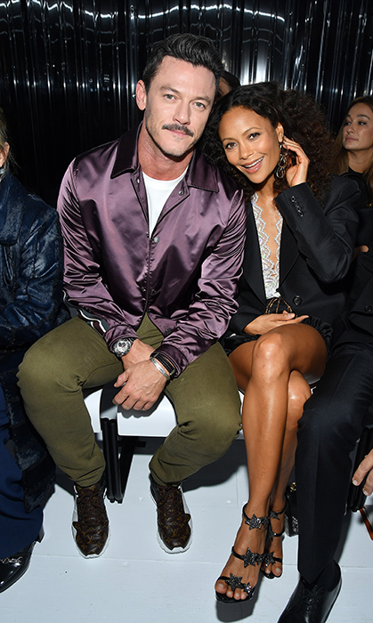 Luke Evans and Thandie Newton sat together at the Louis Vuitton show.