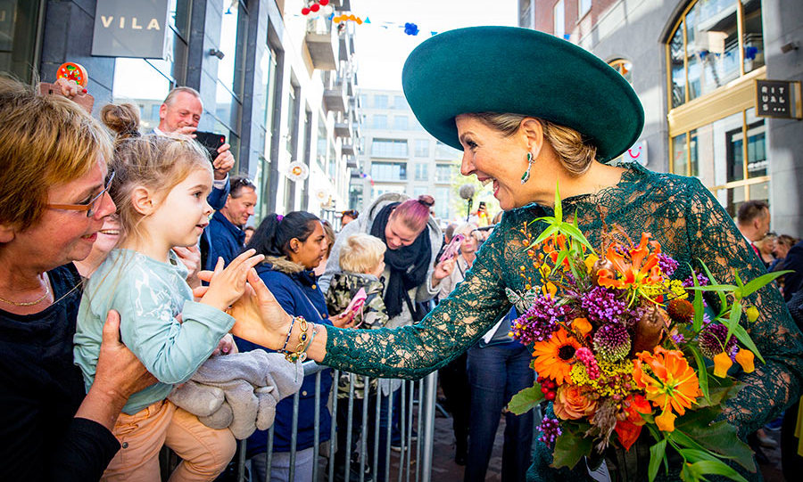 Queen Maxima greeted a little fan while feting the 20th anniversary of the Leidsche Rijn area in Utrecht, Netherlands on Oct. 5. The monarch wore a beautiful green lace dress with one of her signature oversized hats. 