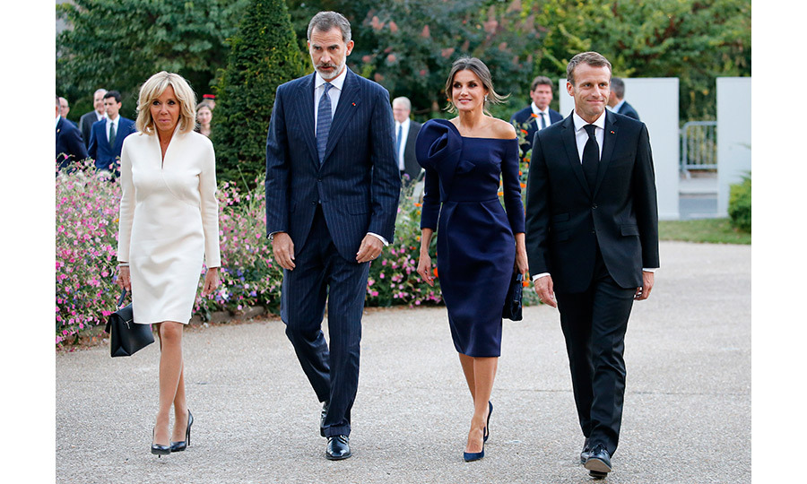 French President Emmanuel Macron and his wife, Brigitte, welcomed Spain's King Felipe and Queen Letizia to Paris, where the foursome took in the 'Miro, La Couleur Des Reves' exhibition before moving on to an official dinner at the presidential palace. Letizia looked radiant in a blue off-the-shoulder dress with a large floral applique over one shoulder.