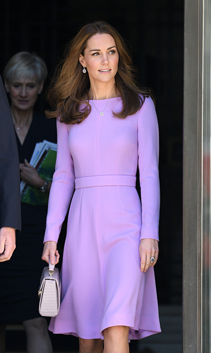 After her casual royal engagement at the Sayers Croft Forest School last week, Kate traded in her Zara moto pants for a recycled look by one of her favourite designers, Emilia Wickstead. The duchess looked radiant in the pastel purple dress (aptly named the 'Kate'), which showed off her figure with its fit-and-flare design.