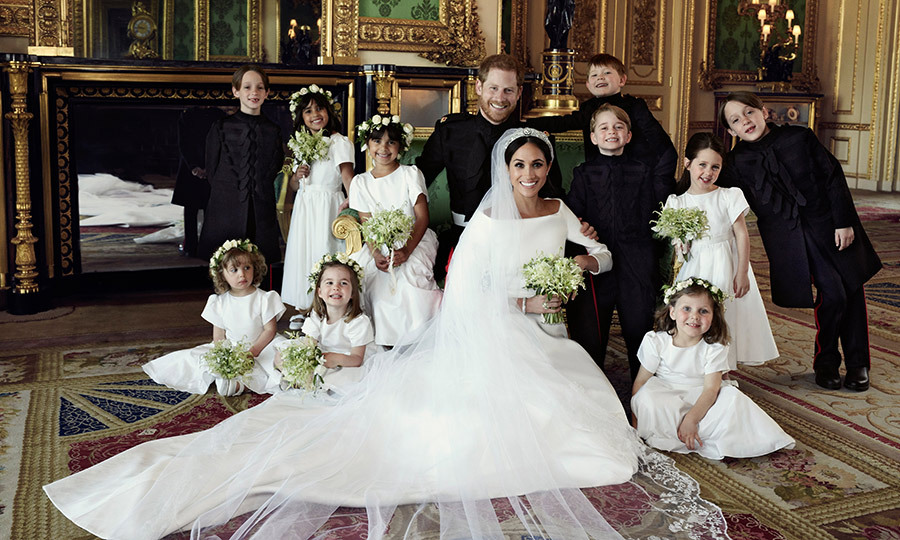 Prince George and Princess Charlotte were two peas in a pod as they gave their biggest smiles to the camera, he standing beside his new aunt Meghan and she seated beside the bride. 