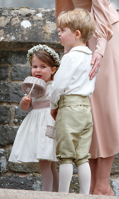Princess Charlotte gave her basket a lick while waiting to tackle her starring role on Pippa Middleton's big day in May 2017. Duchess Kate was poised and ready to heard her children in the right direction.