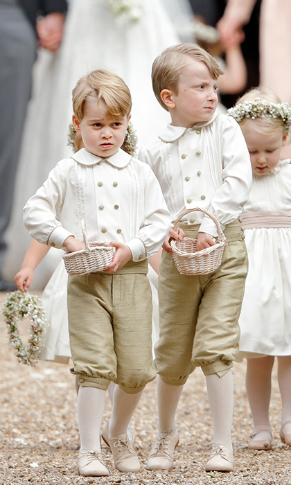 Prince George wore a darling outfit as pageboy at Pippa's wedding - a double-breasted shirt with gold buttons, golden knee shorts, cream tights and matching lace-up shoes. But the most exciting part of his getup for the little boy was definitely the confetti basket!
