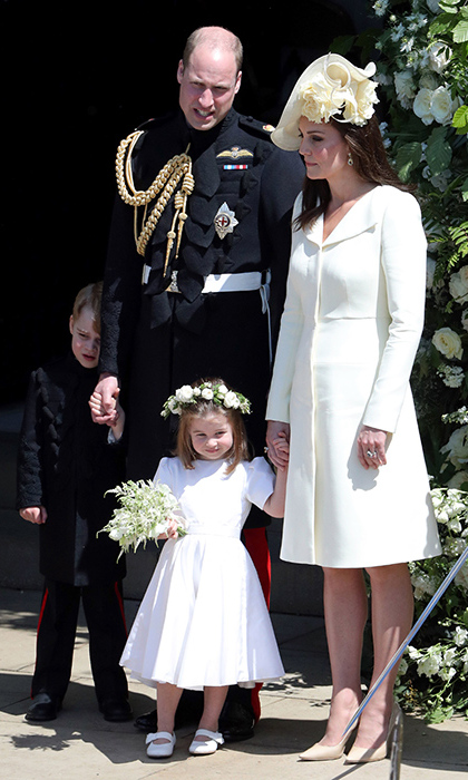 George had an angsty moment after spending hours on his best behaviour as pageboy for his uncle, Prince Harry, and new aunt Meghan Markle. Princess Charlotte, on the other hand, looked happy as a clam in her beautiful silk Givenchy dress, Aquazzura shoes and floral crown.