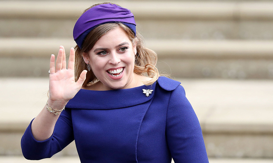 The bride's maid of honour and proud big sister Princess Beatrice stopped to wave to hundreds of well-wishers lined outside the west door of the chapel. The 30-year-old looked picture-perfect in a purple dress by Ralph & Russo and headband by Sarah Cant. 