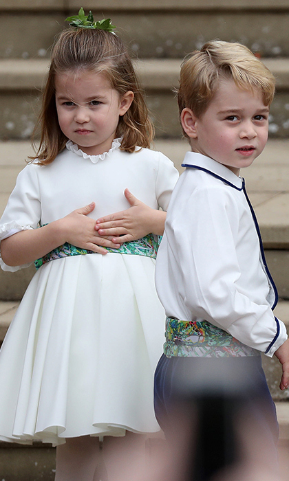 Prince George and Princess Charlotte were in good spirits as they looked at the crowds gathered outside St George's Chapel on Princess Eugenie and Jack Brooksbank's wedding day on Oct. 12, 2018. 