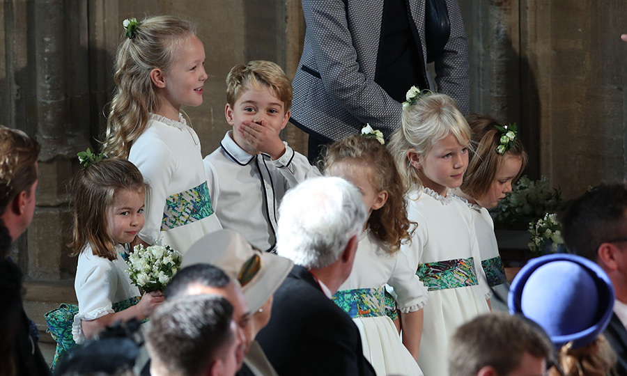 Back with his partner in crime, Savannah Phillips, who stood between George and Charlotte, the future king seems to have stifled a giggle before taking to the aisle.