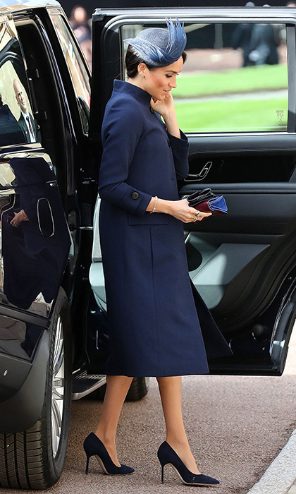The Duchess of Sussex delivered another memorable fashion moment in Givenchy at St. George's Chapel. Just like her wedding day in May, the 37-year-old arrived to the church in an ensemble by the French fashion house. She accessorized her navy blue coatdress with a hat by Noel Stewart, clutch and matching shoes. 