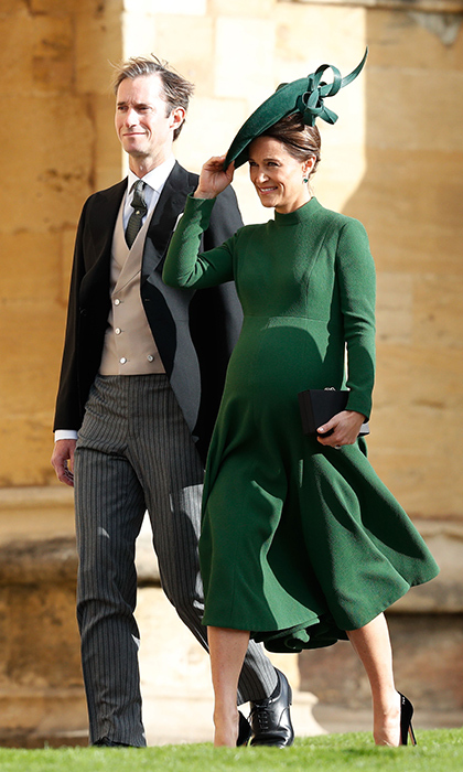 Despite being close to her due date, Pippa Middleton made the trip to Windsor with her husband James Matthews. The mom-to-be kept warm in a long-sleeve, high-neck emerald green dress by Emilia Wickstead, which she paired with an oversized green hat. 