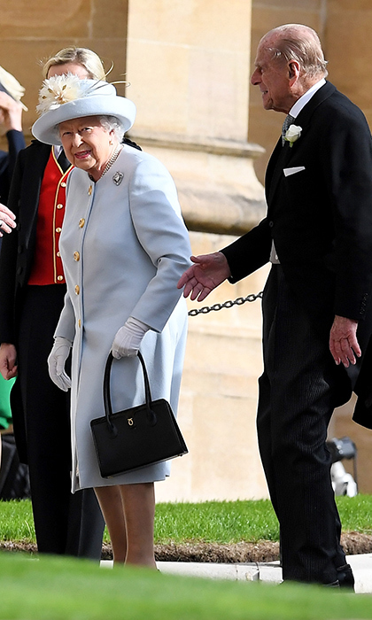 Last to arrive before the bride was the Queen, who slipped into a lovely ice blue coat by Angela Kelly for her granddaughter's special day. She arrived with her husband, Prince Philip, who is said to have waited until this morning to decide whether or not he'd attend the ceremony due to his age and recovery from surgery. 