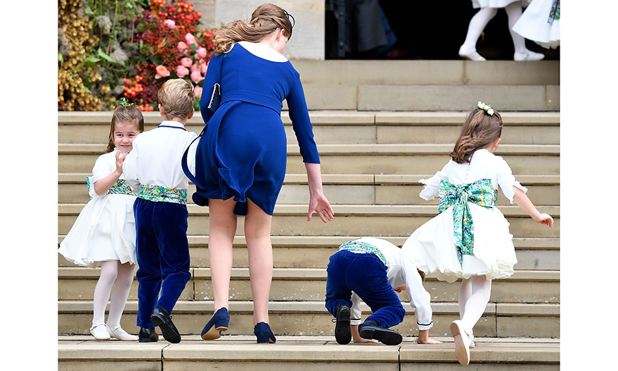 Pageboy Louis de Givenchy took a little tumble on the stairs, as did Princess Charlotte, but the bride's cousin, Lady Louise, was there to help. Prince Edward's daughter, who acted as a special attendant in the bridal party, was in charge of all the little ones. 