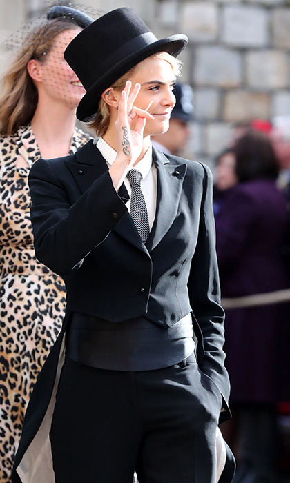 The only thing better than Cara Delevingne's three-piece suit is her jaunty top hat! The 26-year-old model turned actress happily waved to royal watchers as she made her way to the chapel. 