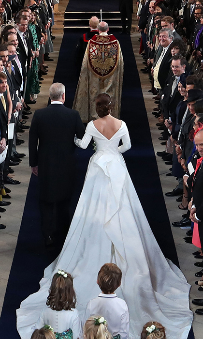 "Princess Eugenie's gown is even more spectacular from the back! The Royal Family released a statement explaining details of the dress, including the significance of the low-back design. ""The low back feature on the dress was at the specific request of Princess Eugenie who had surgery aged 12 to correct scoliosis."" Showing off her scar, the princess hopes to inspire others suffering from curvatures of the spine.