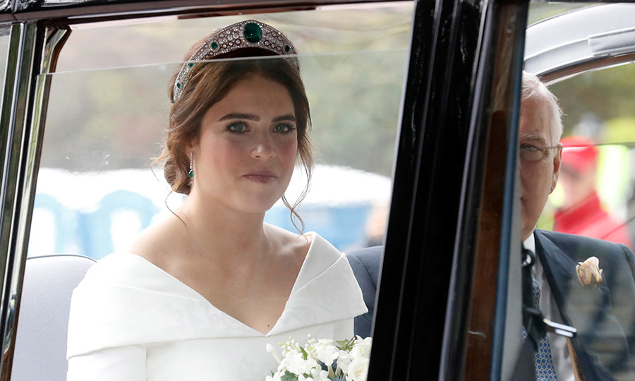 Princess Eugenie wore the Queen's Greville Emerald Kokoshnik Tiara. Made by Boucheron  in 1919, the topper features brilliant and rose cut diamonds set in platinum and six emeralds on each side. 