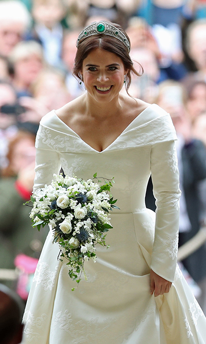 The bridal bouquet was created by Patrice Van Helden Oakes, sister of florist Rob Van Helden, and consisted of Lily of the Valley, Stephanotis pips, hints of baby blue thistles, white spray roses and trailing ivy. And in keeping with royal tradition, it had sprigs of myrtle from a posy planted at Queen Victoria's family home. Her daughter Princess Victoria was the first royal bride to carry it in her bouquet back in 1858 and everyone from Her Majesty to Duchesses Kate and Meghan have carried it since.