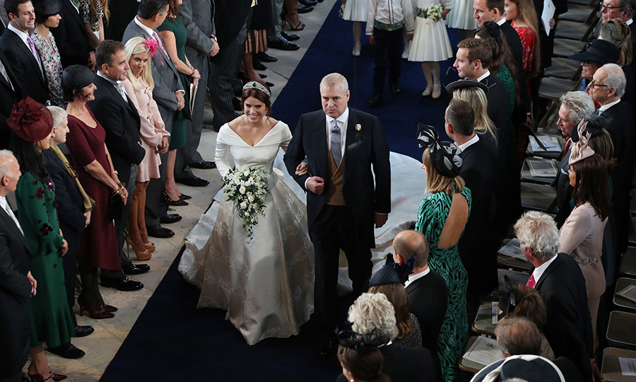The bride, followed closely by her adorable page boys and bridesmaids, beamed as she made her way to the altar. 