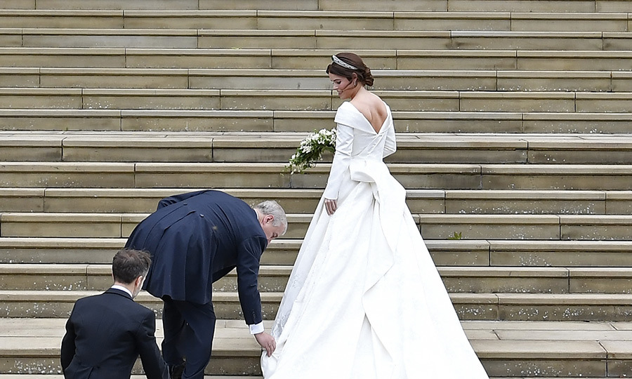 Dad's on it! Prince Andrew stopped to fix his daughter's train on the way up the west steps. 