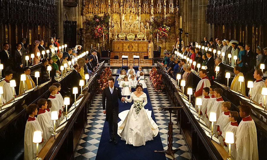 Jack and Princess Eugenie officially started their journey as husband and wife! The choir of St George's Chapel, seen here lining the aisle, also performed at the wedding of Prince Harry and Meghan. 