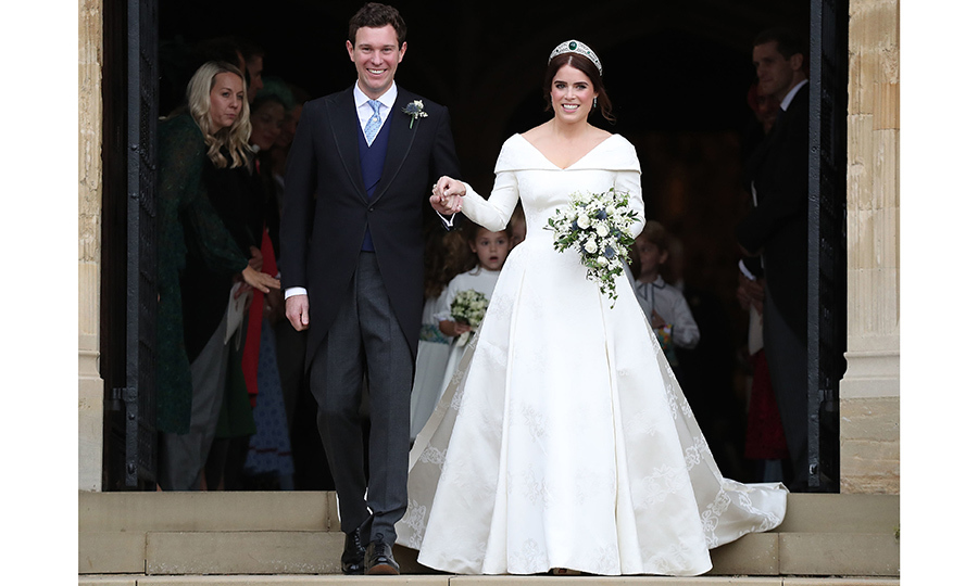Introducing the newlyweds! The pair couldn't stop smiling as they emerged from the chapel. 