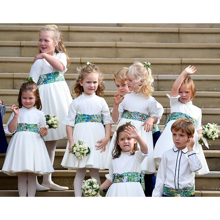 Talk about an adorable wedding party! (From left) Princess Charlotte, Savannah Phillips, Maud Windsor, Prince George, Isla Phillips, Theodora Williams, Mia Tindall and Louis de Givenchy waved goodbye to the newlyweds. 