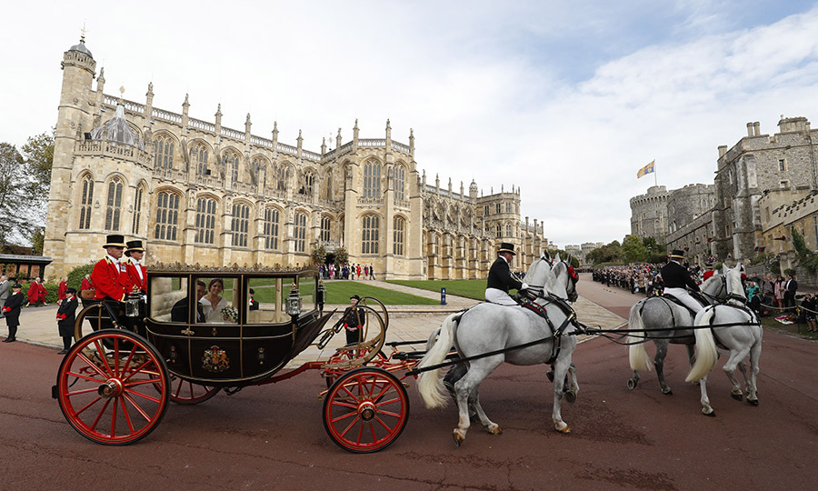 The Queen's Scottish State Coach was pulled by the same four Windsor Grey horses that led Prince Harry and Meghan's procession in May.  