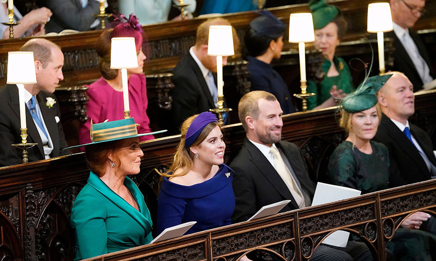 The front row consisted of Sarah Ferguson, Princess Beatrice, Peter Phillips and his Canadian wife Autumn. The latter had the perfect vantage point to watch their children, Savannah and Isla, walk in the adorable wedding party alongside their cousins. 