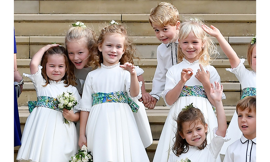 Princess Charlotte had her hand up as she posed with the rest of the bridesmaids in their sweet Amaia Kids dresses with patterned green bows. George, meanwhile, was mugging it for the camera while holding his pal Savannah's hand.