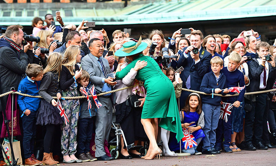 Ecstatic mother-of-the-bride Sarah Ferguson hugged a fan outside St George's Chapel.