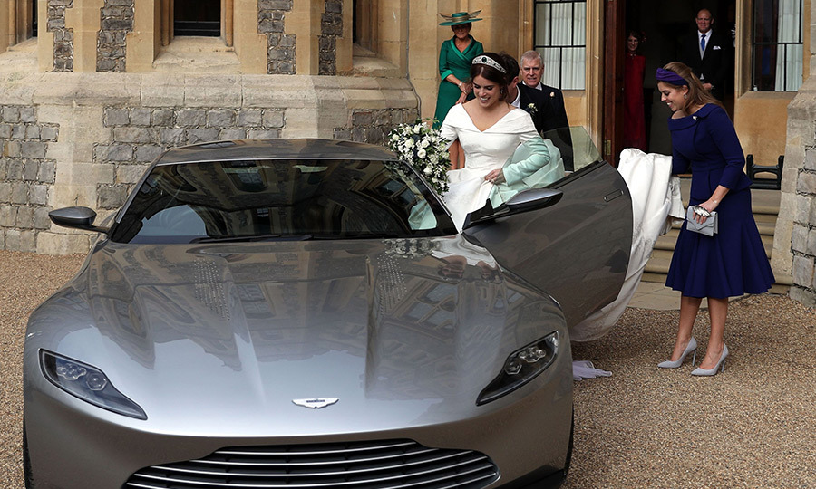 Originally made for the James Bond movie <em>Spectre</em>, the DB10 Aston Martin made for a seriously stylish exit from their first reception at Windsor Castle. Beatrice was poised and ready to get her sister's dress into the small car!