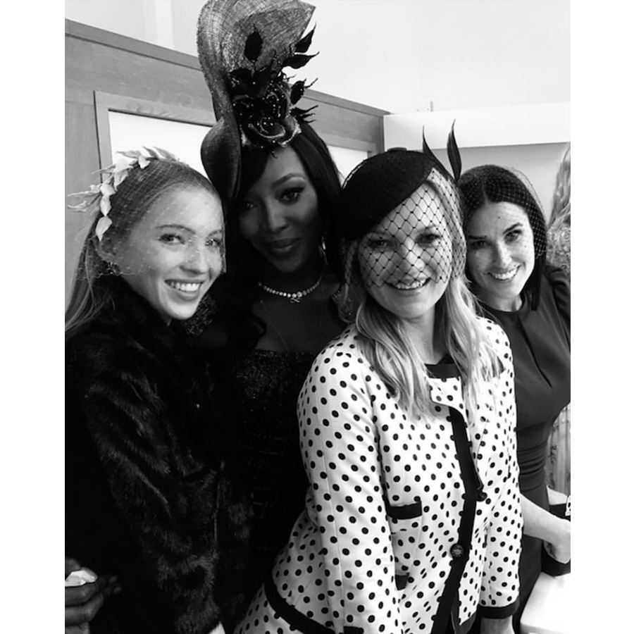 "Supermodels Naomi Campbell and Kate Moss posed with Demi Moore and Kate's daughter Lila posed for this epic photo in the washroom at Windsor Castle. Liv Tyler snapped the shot with the caption: ""I couldn't resist stealing this sweet moment of these beauties in the powder room.""