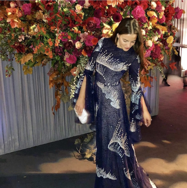 This photo of Cleo Von Adelsheim shows off the stunning draped walls and autumnal floral arrangements at Eugenie and Jack's evening party, where friends and family toasted the couple until the wee hours.