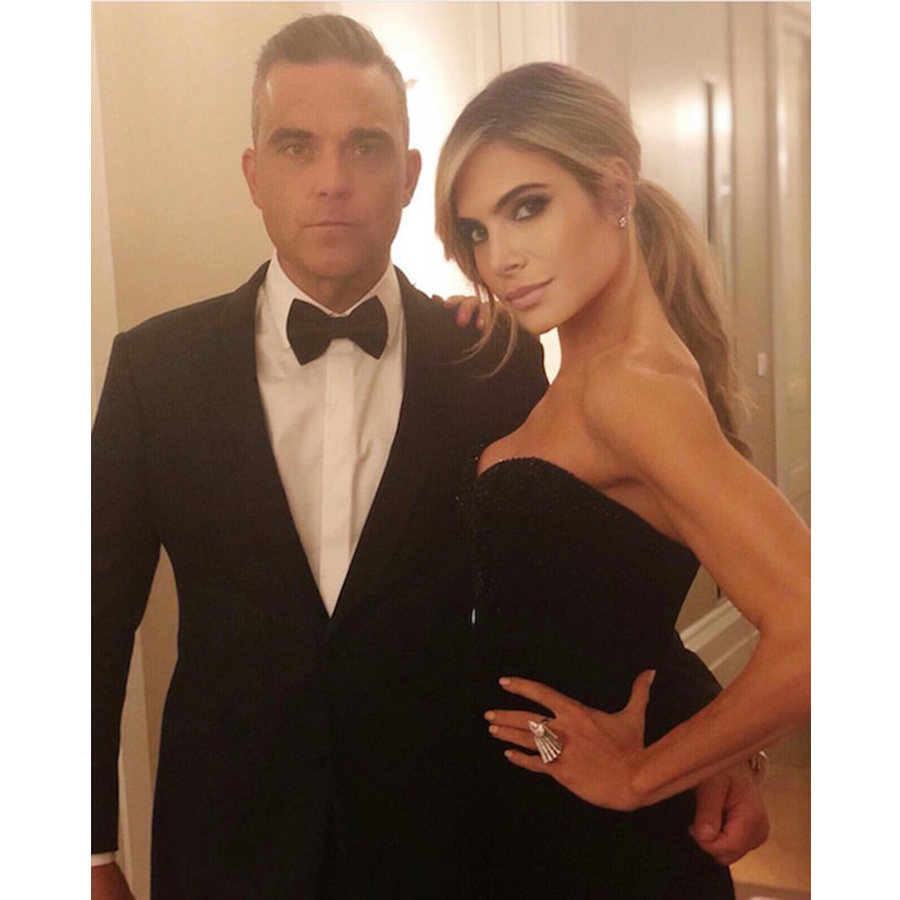 "Once their little bridesmaid Teddy had gone to bed, Robbie Williams and Ayda Field amped up the glamour for a date night at the couple's glam reception. The singer wore a stylish tuxedo while his wife stunned in a strapless black gown. She captioned the photo: ""Celebrating the bride and groom on an evening of love and a lifetime of happiness… to Eugenie and Jack.""