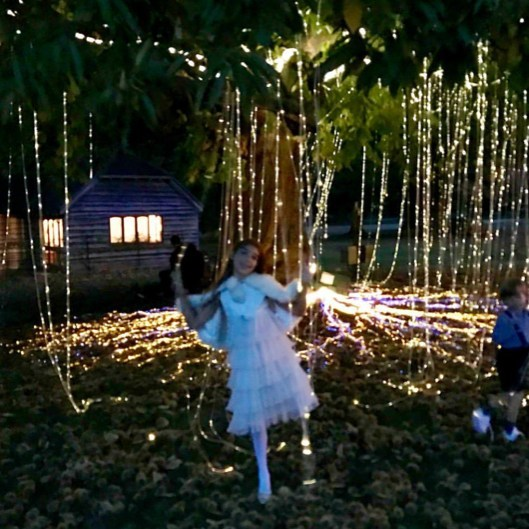 "Tamara Beckwith Veroni's daughter posed under the ""magical trees."" Her mom captioned the snap: ""Magical Moments.. @sarahferguson15  #bestgodmummy  #magicaltrees @princesseugenie  @beayork ♥️ #weddingfever  @marinaveroni1."" 