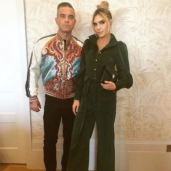 "Robbie Williams and Ayda Field, whose daughter Teddy was a bridesmaid, were dressed to impress for the third time around for the final fete! The singer wore an embroidered bomber with black pants while his wife slipped into a green jumpsuit. She captioned this photo: ""Off to the fairgrounds with @robbiewilliams.. #saturyay.""