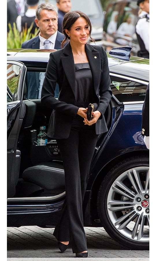 Meghan stepped out for the WellChild Awards on Oct. 4 looking every inch the fashion maven - and carrying her Stella McCartney clutch in a very strategic place! The star slipped into her trademark suited look in an Altuzarra blazer and flared pants, a silk camisole by Deitas and Aquazzura '105' pumps. She wore a bronzy glow and fashioned her hair in her classic messy bun.