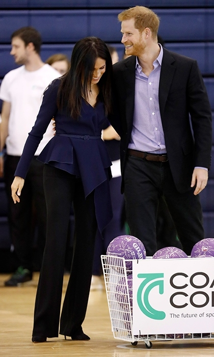 The Duke and Duchess got sporty for a day at Loughborough University for a Coach Core event. Meghan paired sky-high heels with a pair of Altuzarra trousers and a beautiful draped Oscar de la Renta blouse, perfect for concealing a budding bump!