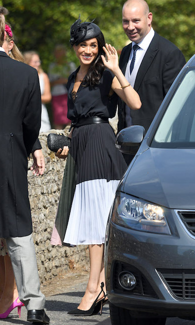 For one of her first outings as a pregnant royal (and on her birthday, no less!), the duke and duchess attended Charlie van Straubenzee's wedding looking more loved-up than ever! Meghan stunned in the Club Monaco Shoanah dress, her trusty Aquazzura Deneuve Bow pumps and accessorized with a straw Kayu clutch and Linda Farrow sunglasses.
