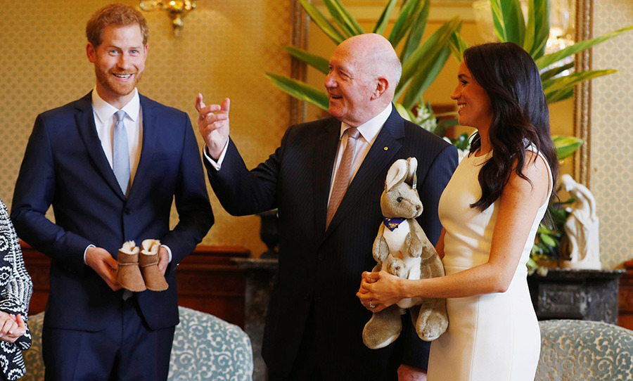 Just hours after making their baby news known, Prince Harry and Meghan paid a visit to Admiralty House – where they'll be staying while in Australia – to meet with Governor-General Sir Peter Cosgrove and his wife, Lady Lynne Cosgrove.