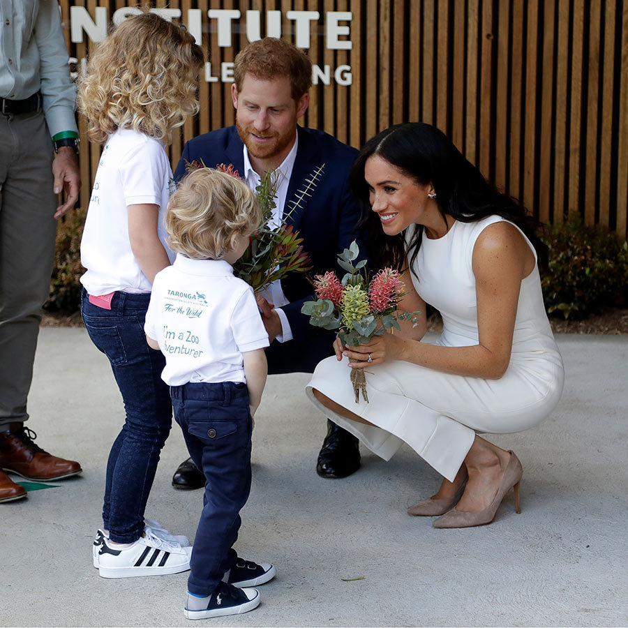 The Duke and Duchess of Sussex made a trip to the famous Taronga Zoo on Oct. 16, and had the sweetest meeting with the cutest youngsters. The kids, Dasha Gallagher and Finley Blue, presented the royals with native flowers during a ceremony. The couple showed off their natural connection with kids, giving fans a little look into their futures as parents!