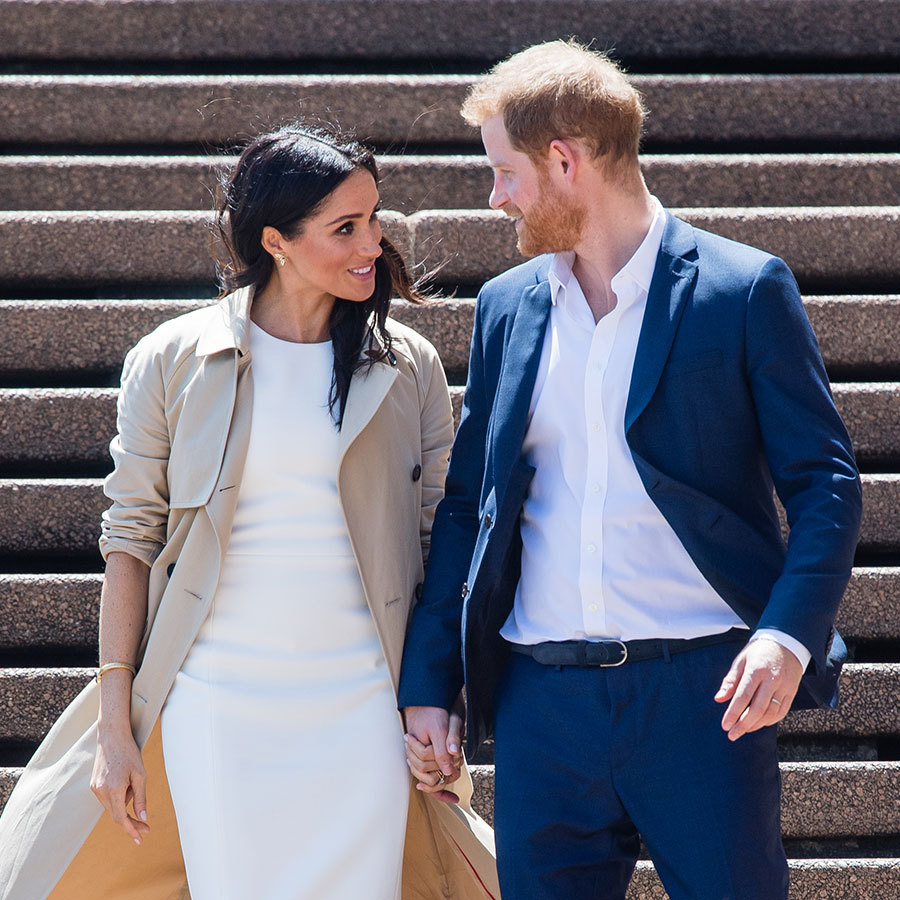 Meghan and Harry are the Duke and Duchess of PDA! The two are rarely seen not holding hands, and their arrival at the Sydney Opera House didn't disappoint. Looking happily into each other's eyes – likely predicting the many baby questions from their admirers! – the couple embarked on their first walkabout of the tour.