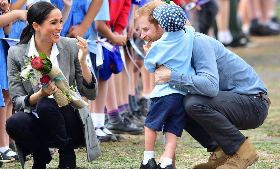 The little boy broke free from the line and gave his favourite prince a big hug. Harry was definitely showing off his paternal side!