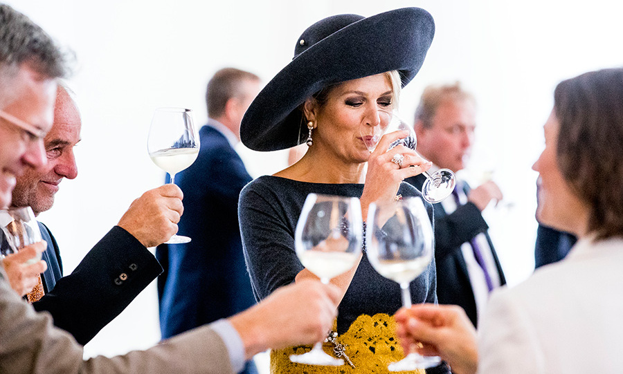 Cheers! Queen Maxima tasted some wine in Mainz, Germany on Oct. 10 while on a three-day visit with her husband, King Willem-Alexander. The monarch wore one of her signature wide-brimmed hats for the occasion.