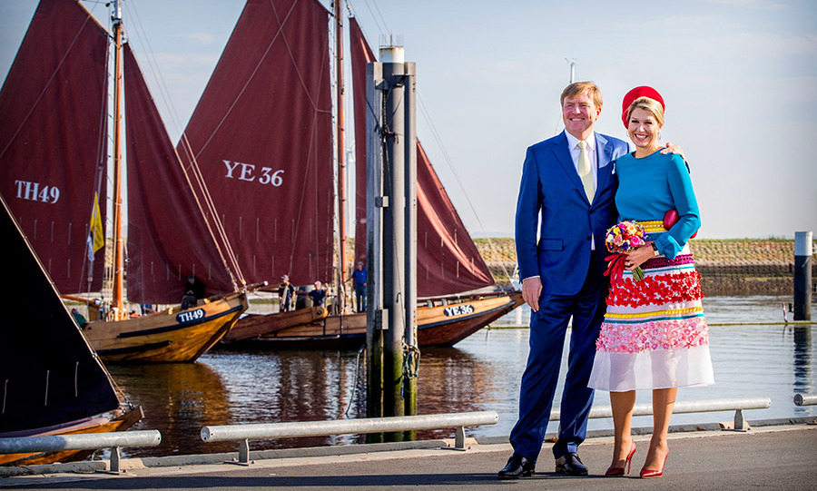Perfectly picturesque! Dutch monarchs King Willem-Alexander and Queen Maxima visited Schouwen-Duiveland en Tholen in the Zeeland province of the Netherlands on Oct. 16, where she stole the show in a colourful ensemble.