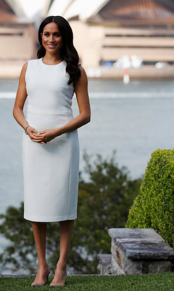 Meghan showed off the tiniest hint of a baby bump in Sydney, wearing a white dress by local designer Karen Gee.