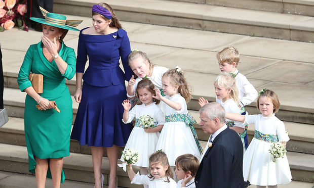 The mother and sister of the bride waved the newlyweds off in their carriage alongside their gaggle of adorable bridesmaids and pageboys.