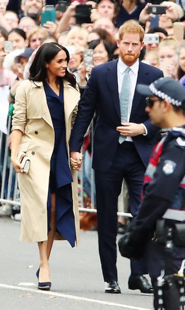 The Duchess of style has done it again! The gorgeous brunette, following a very casual look yesterday, donned a navy-blue sleeveless dress by Australian designer Dion Lee and the same beige Martin Grant Trench Coat she wore yesterday. Pairing the look with chic navy Manolo Blahnik 'BB' pumps and a cuff bracelet by Shaun Leane, she completed her look with the Gucci 'Sylvie' clutch and wore her hair in pretty, loose waves.