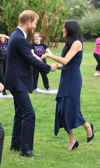 Prince Harry and Meghan showed off their dancing skills while attending the reception at Government House Victoria. They both appeared to be enjoying the fun as everyone watched and laughed along with them!