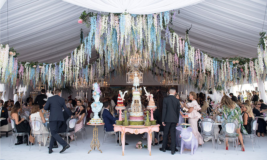"The tents, with chandeliers, hanging wisteria and candelabras dripping in pearls − what Nick affectionately called ""everything that goes on inside Jenna's head, like Willy Wonka's Chocolate Factory"" − were produced by wedding planner Tara O'Grady of Bliss Events. 