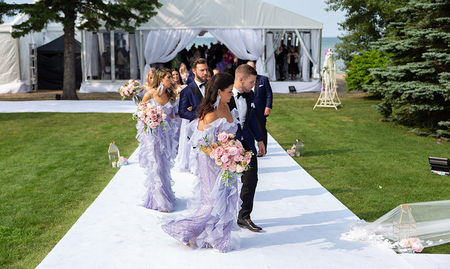 Jenna's bridesmaids carried smaller versions of her own bouquet, as arranged by Jacki O designs, and dazzled in ethereal lavender gowns.
